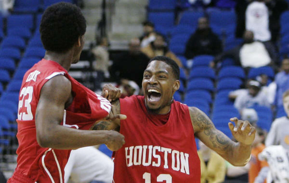 Aubrey Coleman, right, celebrates with forward Bryce Clark after the Cougars rallied from a nine-point deficit to win the Conference USA tournament.