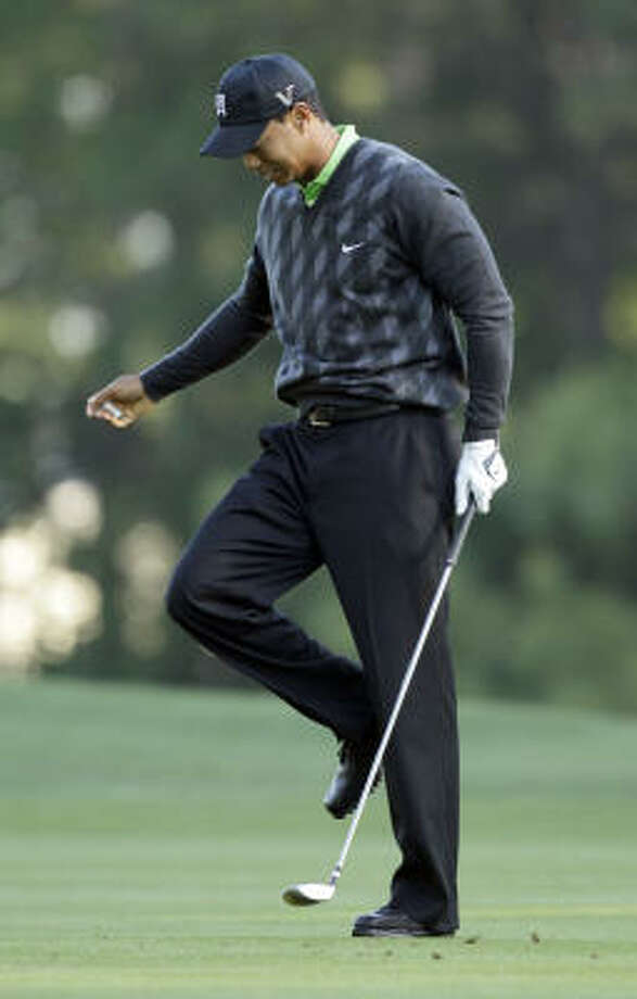 Tiger Woods sent drives into the water on two consecutive holes. Photo: Chuck Burton, AP