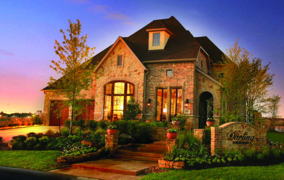 DARLING DESIGNS: Priced from the $440,000s, home exteriors are finished with extensive brick detailing, natural stone and cast stone, and cedar garage doors.