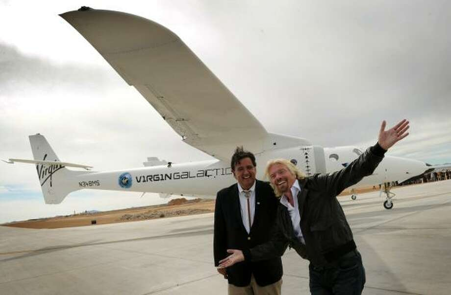 Virgin boss Richard Branson, right, and New Mexico Gov. Bill Richardson were pleased with the Virgin Galactic VSS Enterprise spacecraft's first public landing last week. Photo: MARK RALSTON, AFP/Getty Images