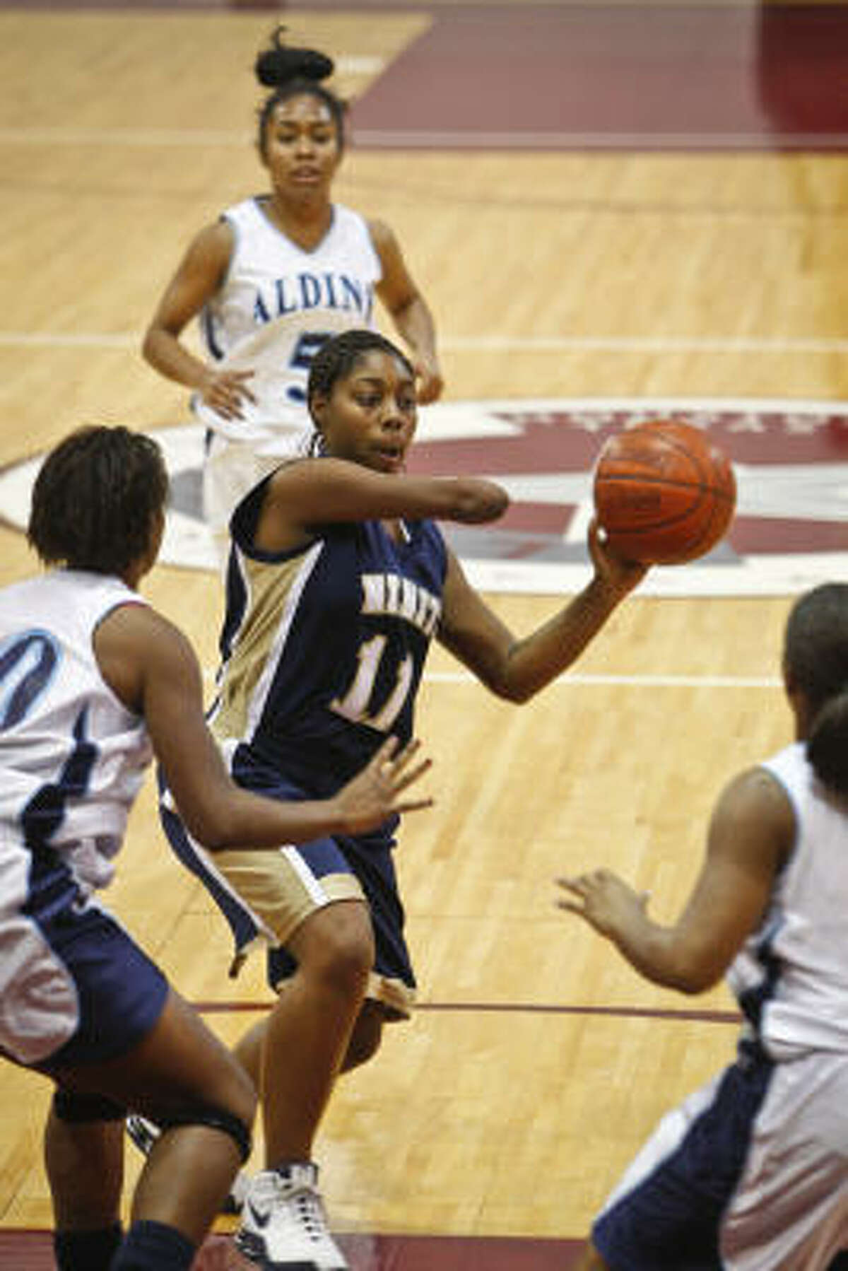 Senior guard Jesse Landry (11) averages approximately seven points and three assists per game off the bench for Nimitz, and she has 13 steals this season.