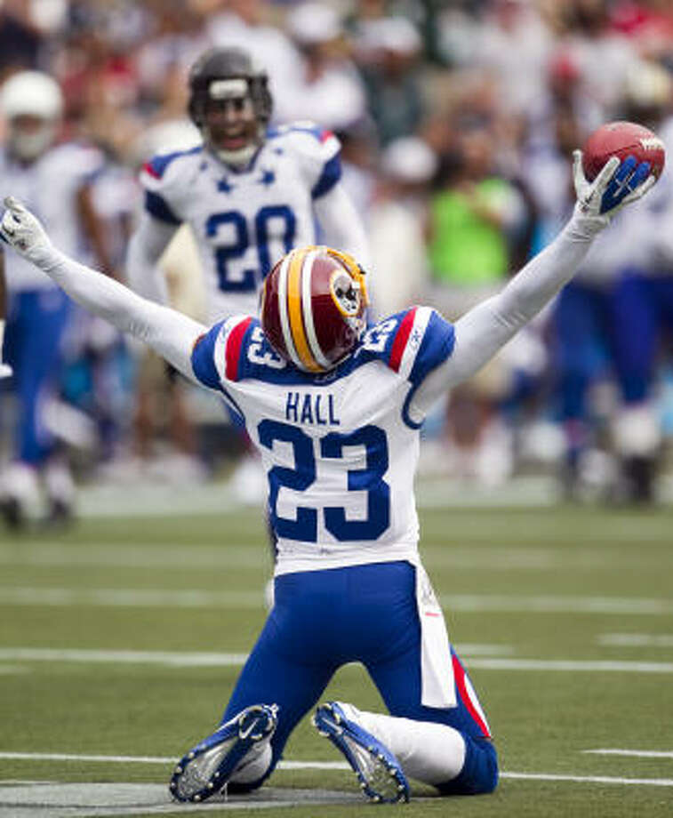 NFC cornerback DeAngelo Hall, of the Washington Redskins, celebrates an interception during Sunday's Pro Bowl. For his efforts, Hall was named the game's MVP. Photo: Marco Garcia, AP