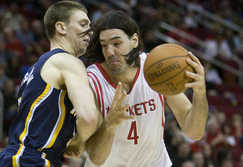 Luis Scola has missed the Rockets' last four games with a sore left knee. Photo: George Bridges, MCT