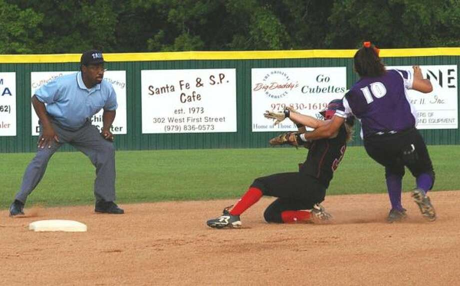 Waltrip's Anne Marie Taylor eludes a tag at second base during the Rams' 2-1 victory over Elgin in the area round of the 4A softball playoffs last week. The win was Waltrip's first ever in postseason softball action. Photo: Paulette Heidbreder, For The Chronicle