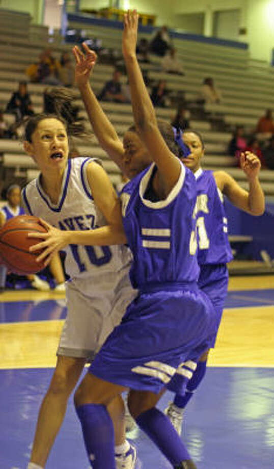 Sierra Soliz, left, led Chavez with 14 points in a win over Westbury. Photo: Gary Fountain, For The Chronicle