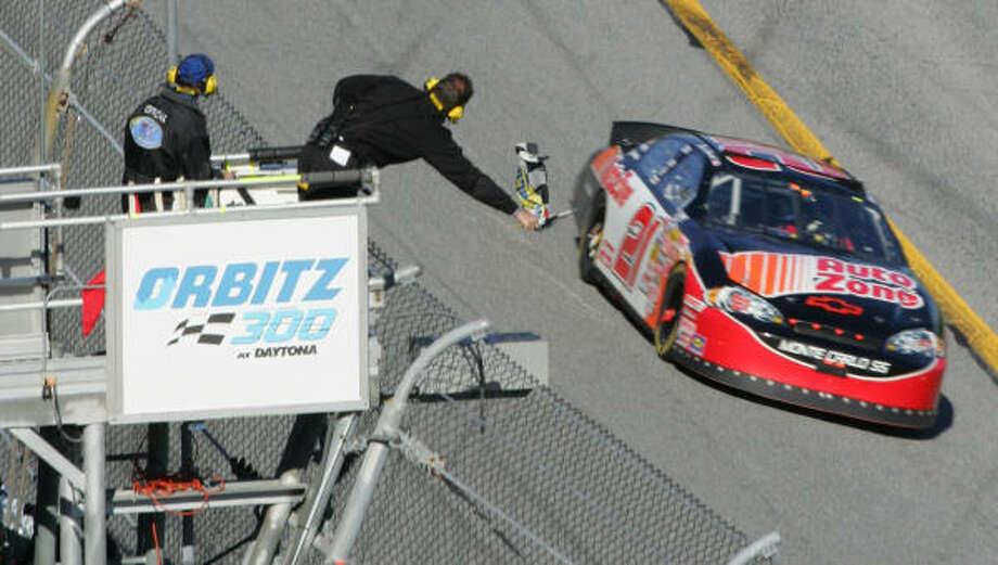 Kevin Harvick takes the checkered flag in the Orbitz 300 at Daytona International Speedway. Photo: David Graham, AP
