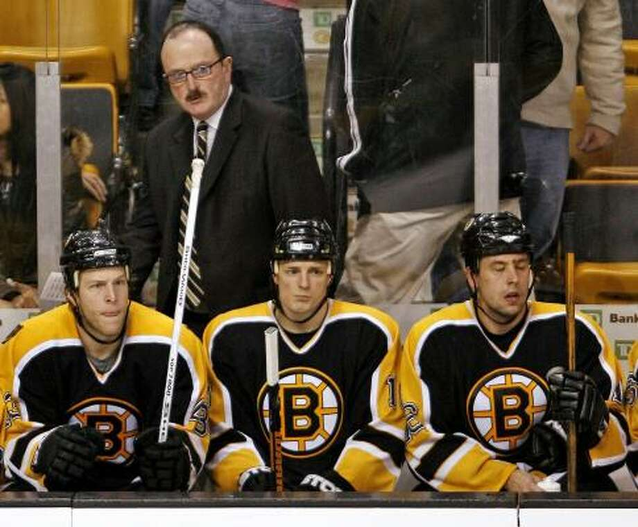 Coach Dave Lewis was reassigned within the Bruins' organization after guiding the team to a 35-41-6 record in his first year as Boston's head coach. Photo: Winslow Townson, AP