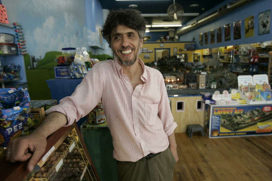 Tim Trewhella poses inside TreatStation, a candy and toy store he runs in Peekskill, N.Y., Wednesday. Trewhella is seeking an apology from his daughter's fifth-grade teacher after the ten-year-old told him she was shown a bootleg copy of Shrek the Third in class. Aside from wasting time that could be better spent educating his child, Trewhella feels that showing a pirated copy of the film sets a bad example. Photo: Ricky Flores, AP