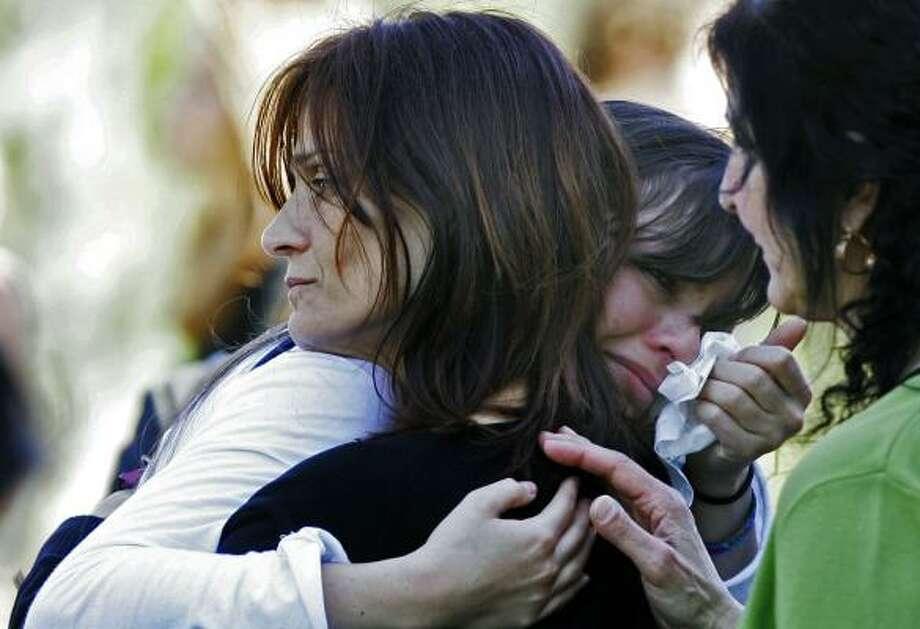 Mona Samaha, mother of Virginia Tech shooting victim Reema Samaha, comforts a friend of her daughter's, Monica Murgia, during a service Saturday in Chantilly, Va. Photo: MANUEL BALCE CENETA, ASSOCIATED PRESS