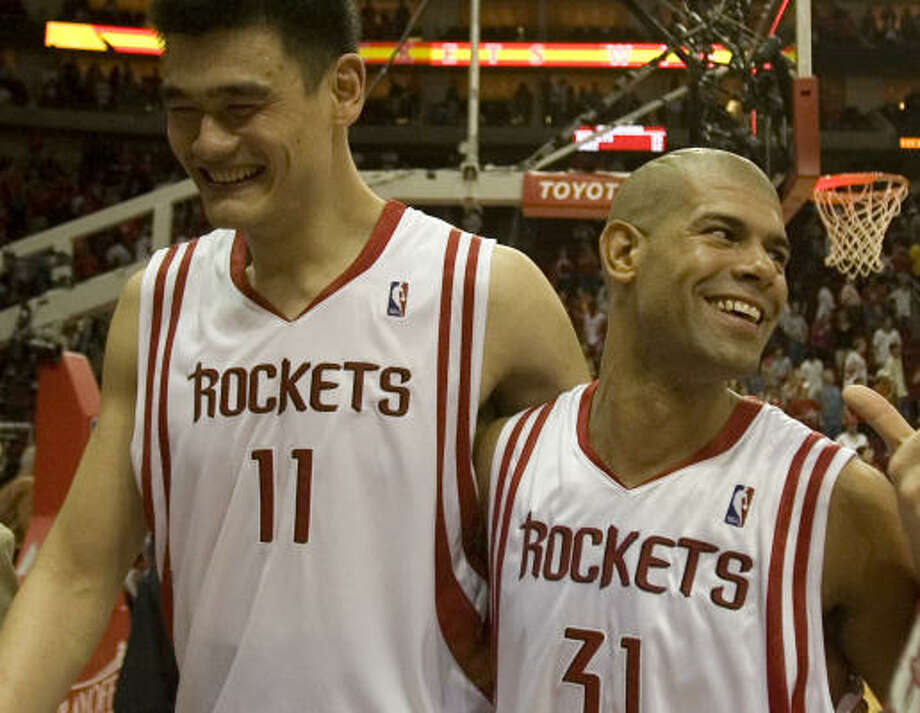 """He was smiling on Saturday, but Yao Ming can get fired up, too. Earlier this season, he was overheard telling another player, """"You can't stop me."""" Photo: Smiley N. Pool, Chronicle"""