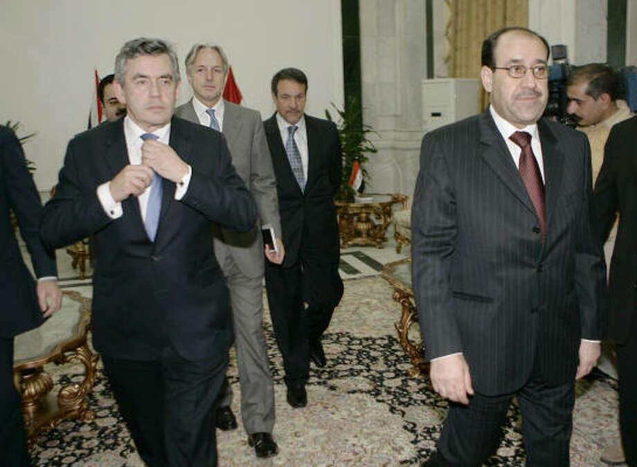 British Prime Minister Gordon Brown, left, visits Iraqi Prime Minister Nouri al-Maliki, right, in the heavily-fortified Green Zone in Baghdad, Iraq, today. Photo: Lefteris Pitarakis, Associated Press