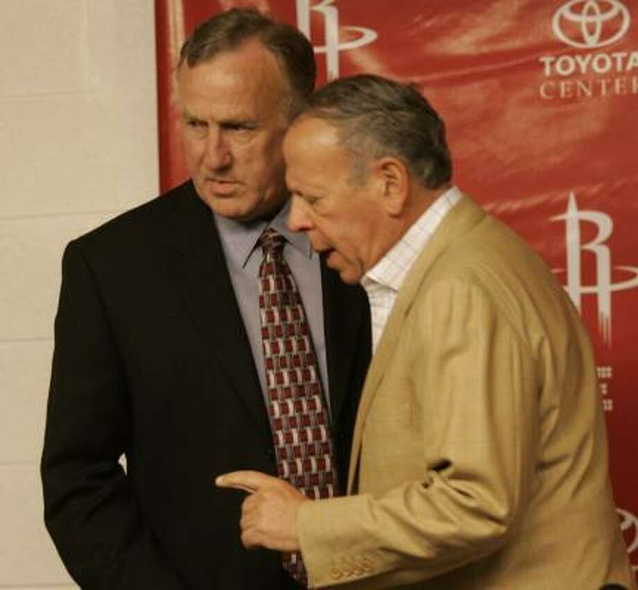 Rick Adelman, left, talks with Rockets owner Leslie Alexander before Wednesday's news conference. Photo: JOHNNY HANSON, FOR THE CHRONICLE