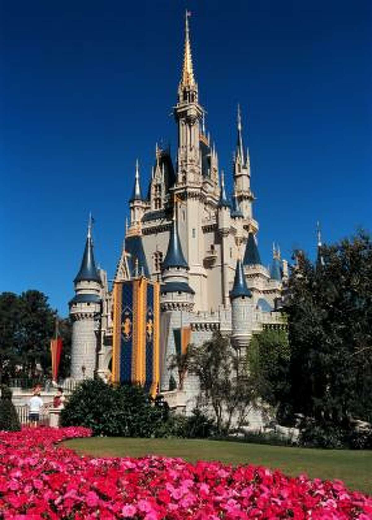 Cinderella's Castle towers above the Magic Kingdom. The landmark castle is an entryway to Fantasyland.