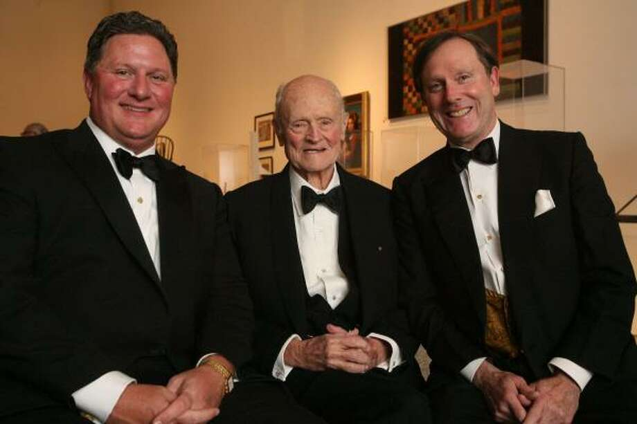 One Great Night in November co-chair Jim Flores, from left, honoree Alfred C. Glassell Jr. and co-chair Bill Wheless led the black-tie men's smoker to a record success. Photo: Bill Olive, For The Chronicle