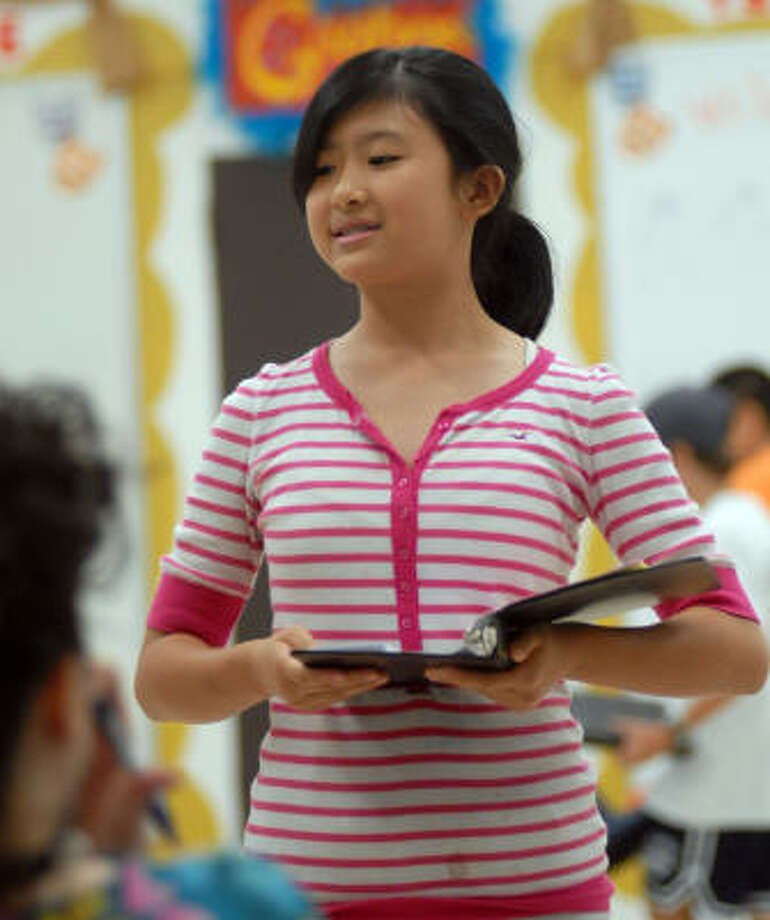 Lanier Middle School debate team member Lucy Chen practices for the National Junior Forensics League Tournament in Greeley, Colo. The team will be seeking its sixth straight title at the event, which concludes Sunday. Photo: Dave Rossman, For The Chronicle