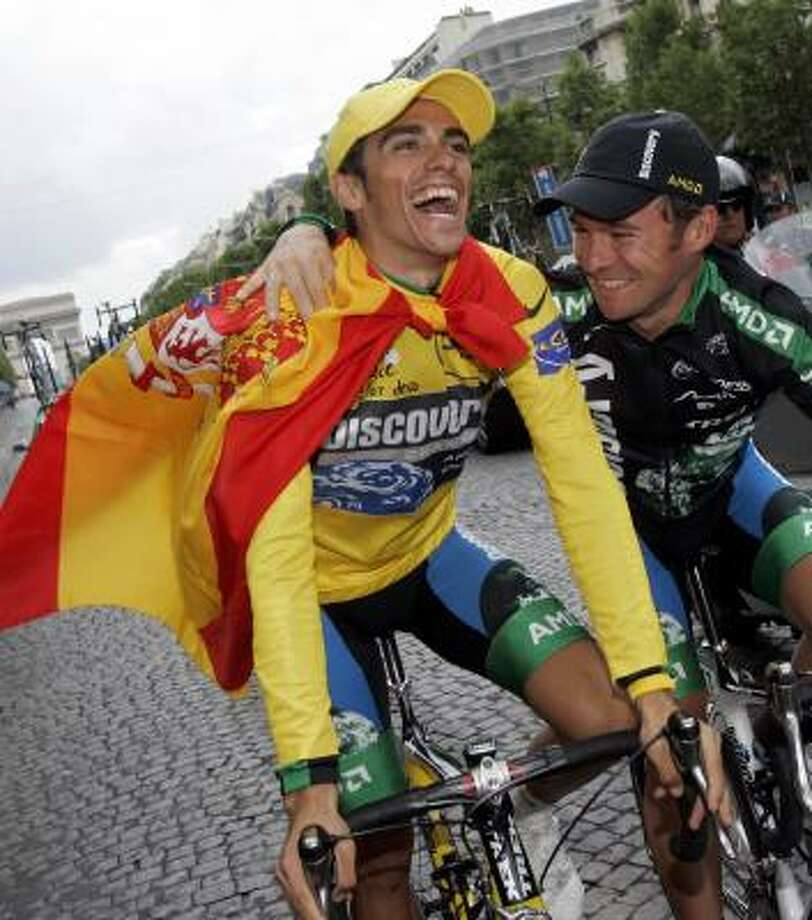 Tour de France winner Alberto Contador of Spain, left, may have caught the eye of a potential corporate sponsor to keep his Austin-based team  afloat with his victory. Photo: CHRISTOPHE ENA, AP