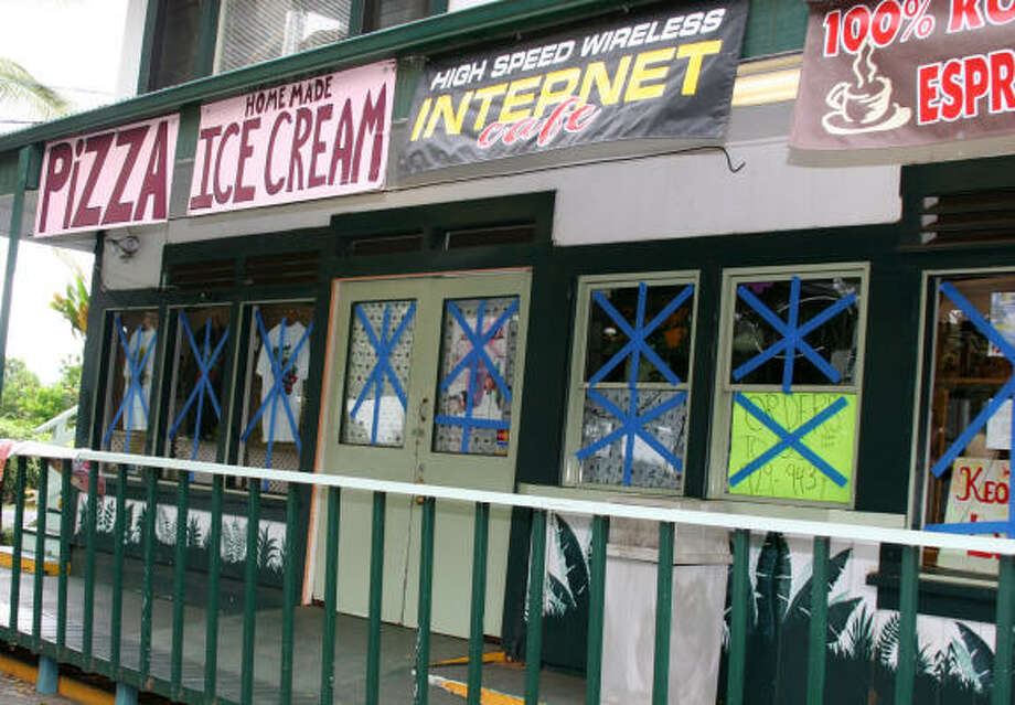 A shop is seen with tape on its windows Aug. 14 in Naalehu, Hawaii. Photo: AP