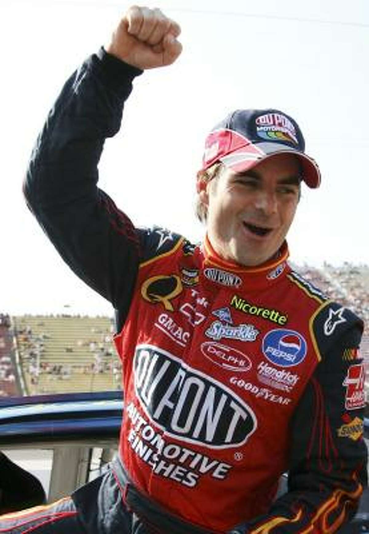 Jeff Gordon, a four-time race winner this season, celebrates his sixth pole of 2007 after beating the field Friday at Michigan International Speedway.