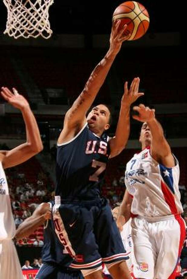 Deron Williams drives past Puerto Rico's Carlos Arroyo during Team USA's victory Tuesday. Photo: NED DISHMAN, GETTY IMAGES