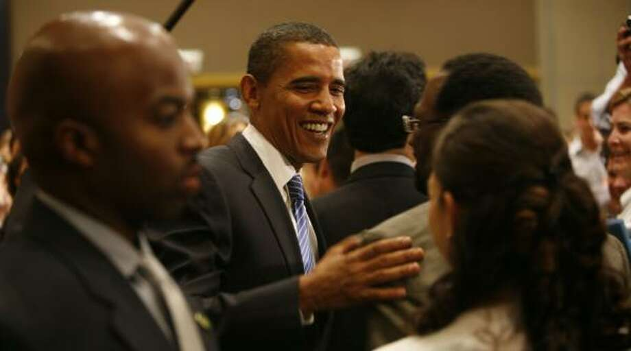 Barack Obama mingles with the audience at DePaul University in Chicago after making a foreign policy speech in which he criticized Congress's vote five years ago to authorize the war in Iraq. Photo: MICHAEL TERCHA, CHICAGO TRIBUNE