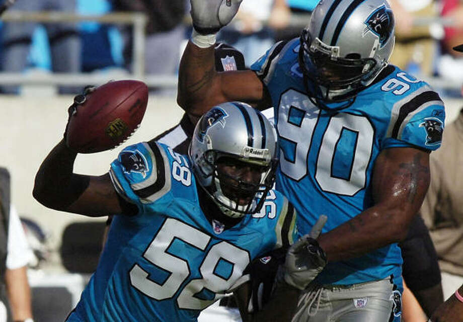 Thomas Davis (58) and Julius Peppers (90) are two of the players many believe DT Kris Jenkins was targeting when he ripped the defense's performance last week. Photo: David T. Foster III, MCT