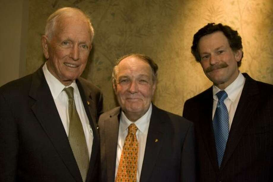Texas Heart Institute founder Dr. Denton Cooley, from left, outgoing University of Texas Health Science Center president Dr. James Willerson and incoming president Dr. Larry Kaiser were among notables at the dinner evening saluting Willerson's tenure at the science center. Photo: JAMES NIELSEN, CHRONICLE