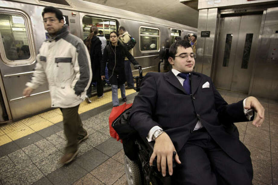 At the center of a fight over accessibility issues in New York's subway system, Michael Harris, right, is campaign coordinator for the Disabled Riders Coalition. Once stranded on the platform because of a broken elevator, he wound up calling firefighters to be lifted to street level. Photo: ADAM ROUNTREE, AP