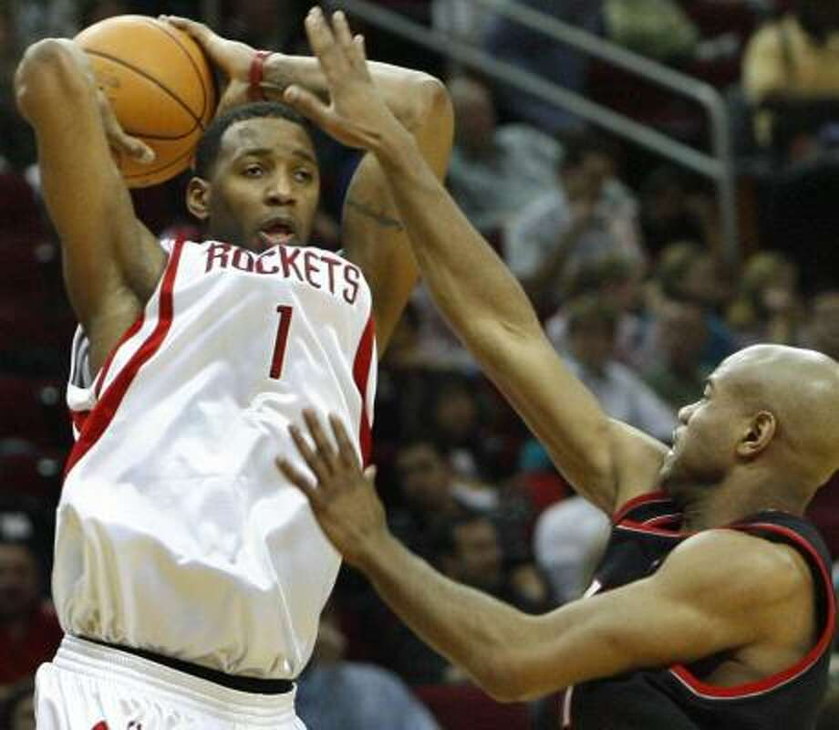 Tracy McGrady (1) finished with 28 points against Portland. Photo: Carlos Antonio Rios, Houston Chronicle