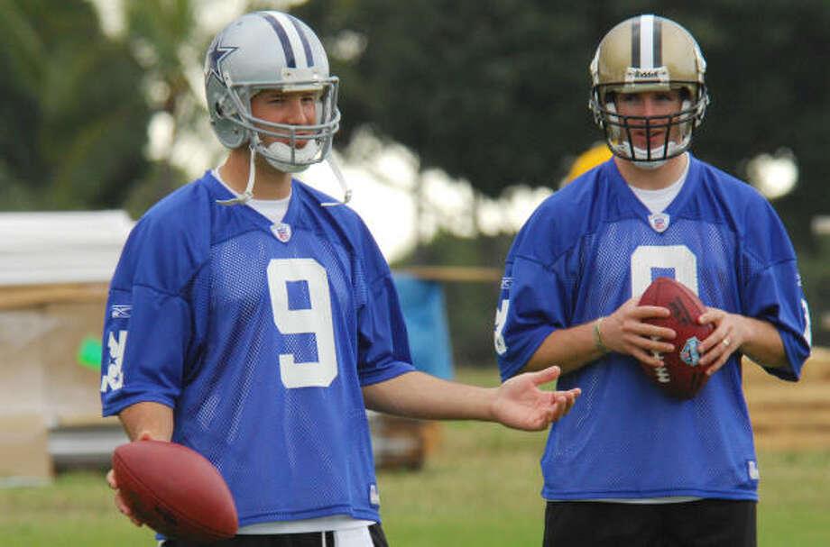 Cowboys quarterback Tony Romo, left, and Saints quarterback Drew Brees keep it light at practice Wednesday. Photo: Ronen Zilberman, AP