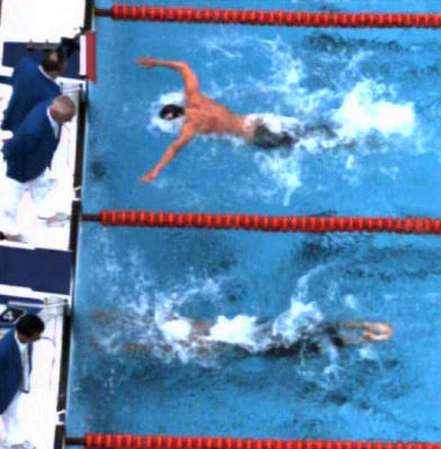 How close was it? This close. Phelps is in the top lane in his finish against Milorad Cavic in this photo (the first of three in a series) taken from the official Olympic pool video. Photo: AP Photo/IOC BOB, Pool