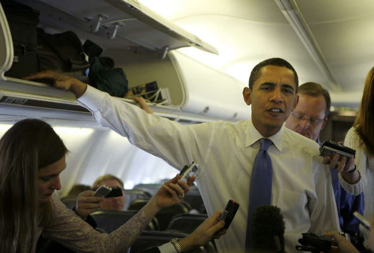US Democratic presidential candidate Sen. Barack Obama of Illinois talks with the media on his campaign plane Wednesday.