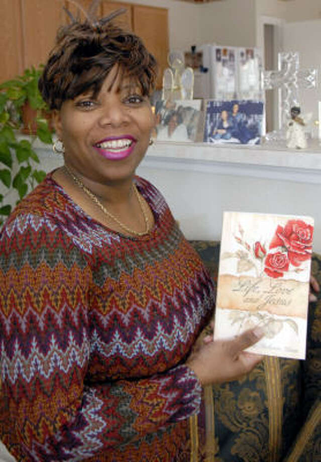 Gina Rivon a Baytown employee poses with her Poetry book she has self-published titled Life Live and Jesus. Photo: Kim Christensen