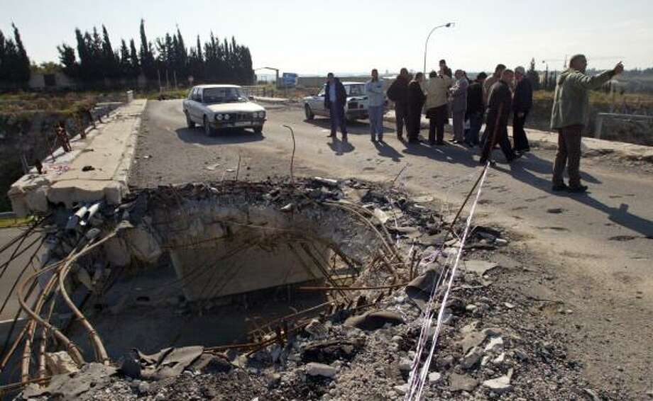 Iranian workers inspect a bridge Jan. 18 that was hit during last summer's Israeli aerial bombardment of Lebanon's southern coastal highway near Saksakiyeh, south of Sidon. Iran is one of many foreign nations helping Lebanon recover from war damage. Photo: SERGEY PONOMAREV, ASSOCIATED PRESS