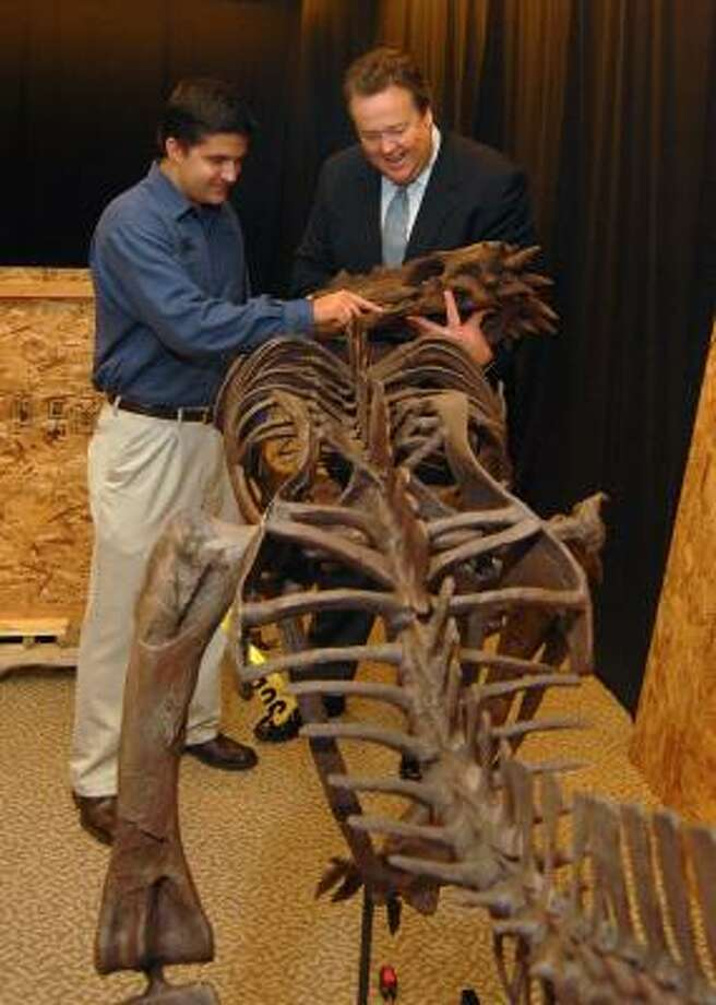 Jeff Gionette, left, assistant general manager of The Woodlands Mall and Joel Bartsch, president of the Houston Museum of Natural Science, examine a dinosaur skull that will be on display at the Houston Museum of Natural Science satellite educational facility. The satellite site will be called Xploration Station, it will occupy the entire first floor of the former Mervyn's store, and it will open March 9. Photo: David Hopper, For The Chronicle