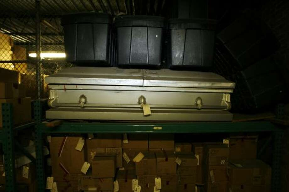 Among the containers stacked in the Houston Police Department's property warehouse is a casket from a homicide case in 1990. The victim was found wrapped in plastic inside the casket in a Montrose townhouse. The case hasn't been solved. Photo: ERIC KAYNE, CHRONICLE