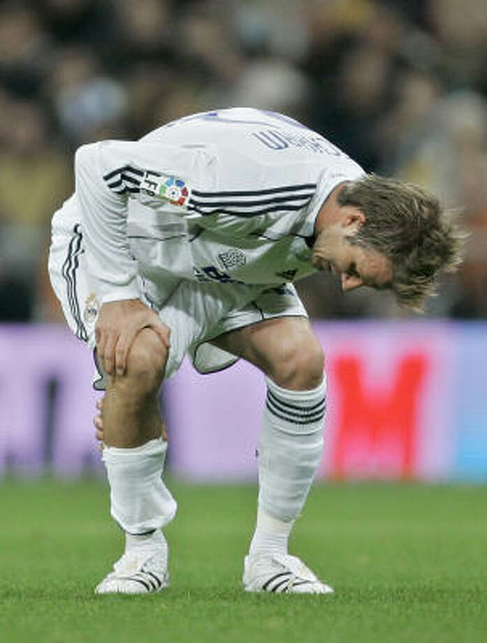David Beckham will be out a month after injuring a ligament in his knee during his Spanish League soccer match for Real Madrid. Photo: JASPER JUINEN, AP