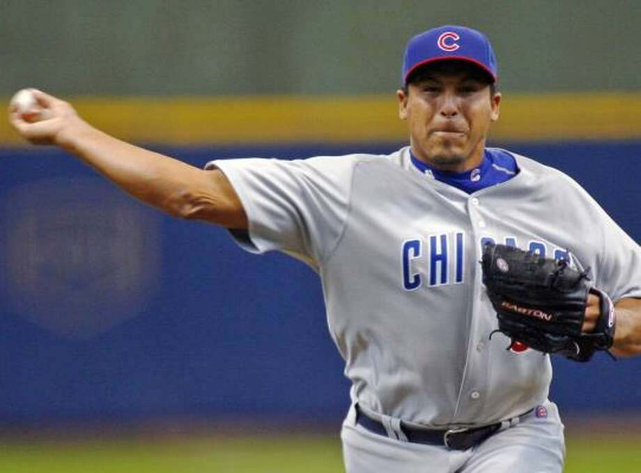 The Cubs got a well-rounded lift from Carlos Zambrano, who pitched the win and added an RBI single. Photo: DARREN HAUCK, ASSOCIATED PRESS