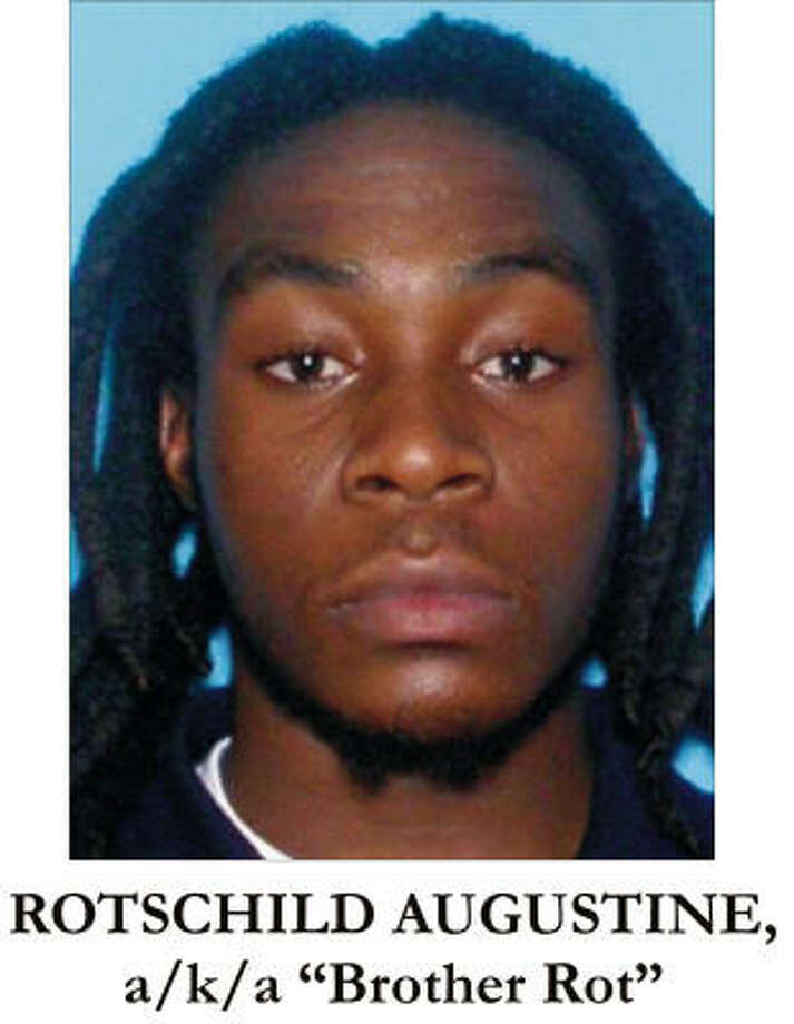 A handout photograph from the U.S. Department of Justice shows Rotschild Augustine. Photo: REUTERS