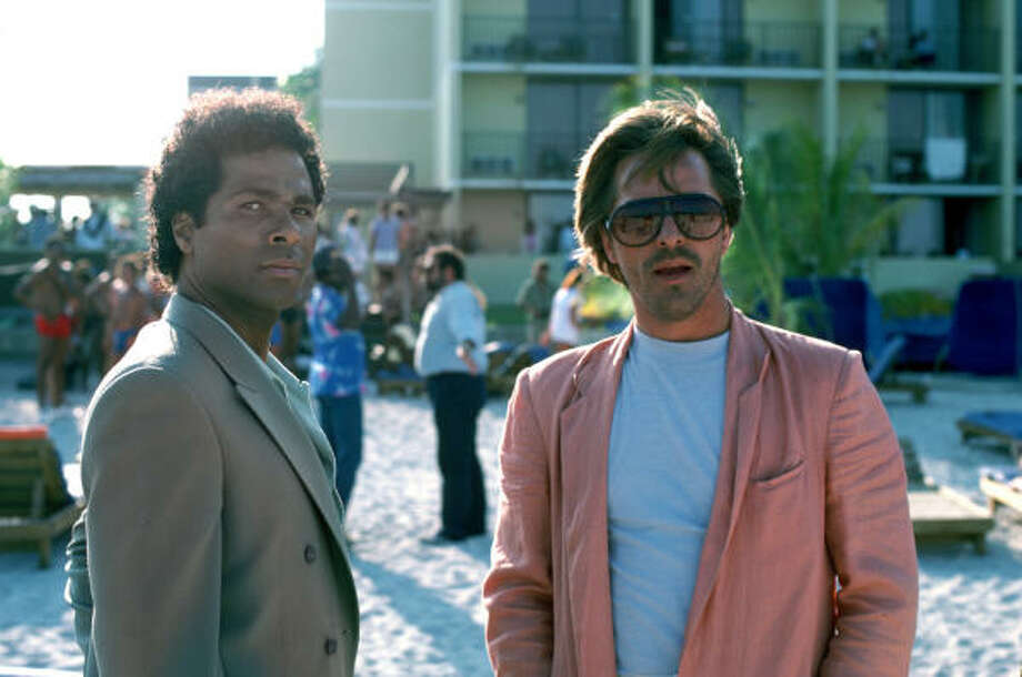 Old vice:Sonny Crockett (Don Johnson, right) and Ricardo Tubbs (Philip Michael Thomas) appear in a scene from the 1980s television police drama Miami Vice. Johnson's character became a fashion plate, setting the styles of many. Photo: Universal Studios, Associated Press