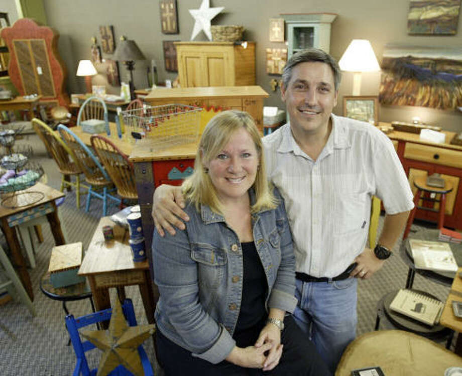 Kay and Chris Thayer operate a boutique on 19th Street in the Heights. The Thayers closed their old business on Magazine Street in New Orleans and decided to settle in Houston. Photo: Jessica Kourkounis, For The Chronicle