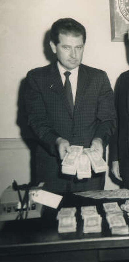 Warren Larson displays confiscated money from an FBI bust of organized crime. Photo: Courtesy Of Larson Family