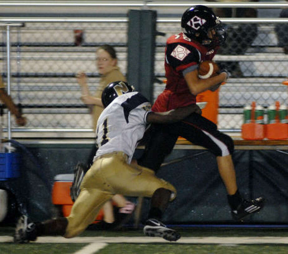 Clear Brook's Brandon Marler (16) runs past Nimitz's Jeremy Johnson in action Sept. 8. Photo: Kim Christensen, For The Chronicle