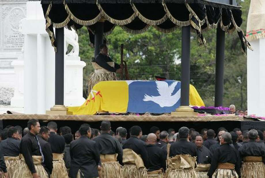 The casket of the late King Taufa'ahau Tupou IV rests at the royal tomb for a state funeral in Nuku'alofa, Tonga, today. Tongans dressed in black and wore traditional mourning mats called ta'ovala wrapped around their waists. Photo: Sandra Mu, Getty Images