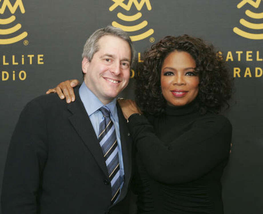 Hugh Panero, president and CEO of XM Satellite Radio, and talk-show queen Oprah Winfrey signed a three-year deal earlier this year for a new radio channel. The channel, Oprah and Friends, will launch at 10 a.m. Monday. Photo: GEORGE BURNS, Associated Press