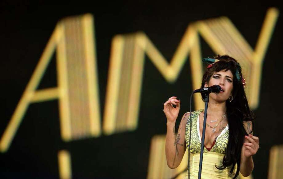 In this July 4, 2008 file photo, singer Amy Winehouse of England performs during the Rock in Rio music festival in Arganda del Rey, on the outskirts of Madrid. Winehouse, the beehived soul-jazz diva whose self-destructive habits 