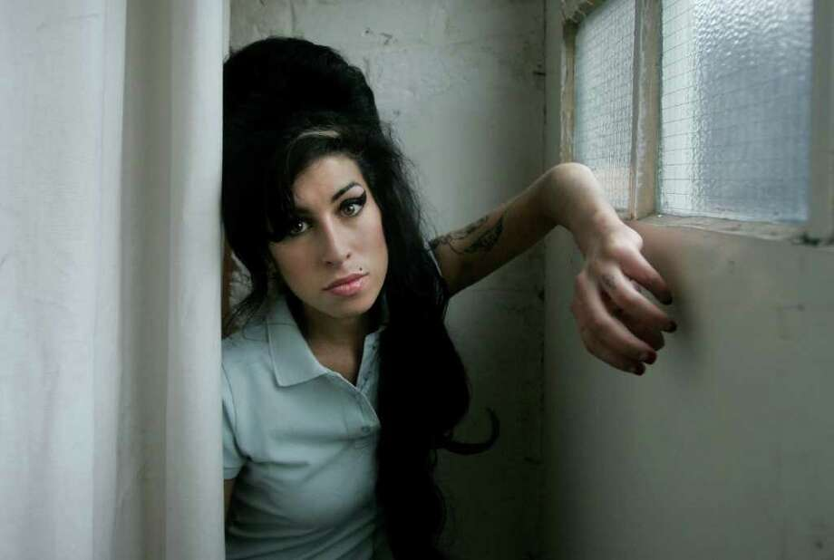 In this Feb. 16, 2007 file photo, British singer Amy Winehouse poses for photographs after being interviewed by The Associated Press at a studio in north London. Photo: AP