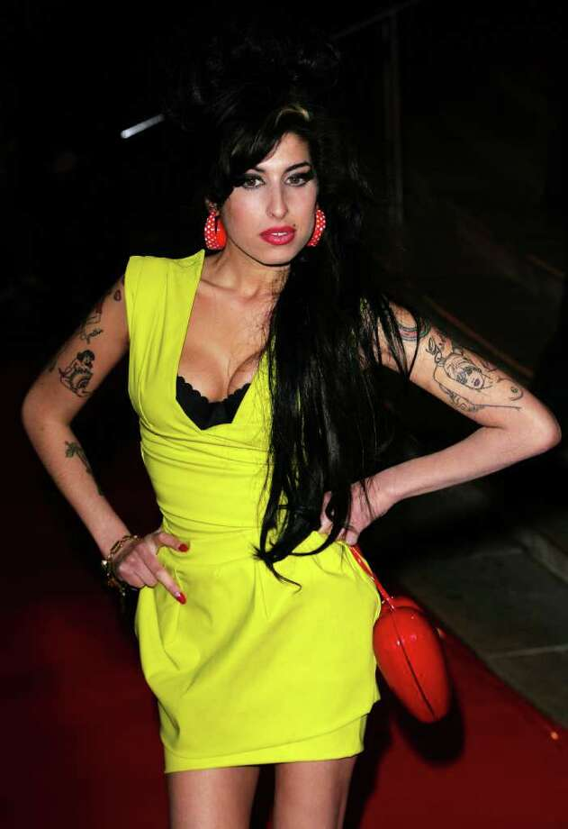 Singer Amy Winehouse arrives at the BRIT Awards 2007 in association with MasterCard at Earls Court on Feb. 14, 2007 in London. Photo: Gareth Cattermole, Getty Images / 2007 Getty Images
