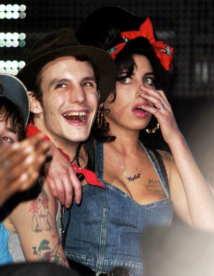Amy Winehouse and husband Blake Fielder-Civil watch the show at the MTV Europe Music Awards 2007 at the Olympiahalle on Nov. 1, 2007 in Munich, Germany. Photo: Dave Hogan, Getty Images For MTV / 2007 Getty Images