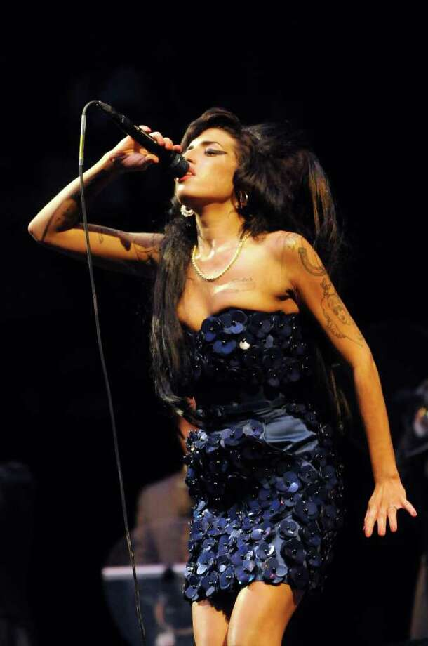 Amy Winehouse performs on the Pyramid stage during day two of the Glastonbury Festival at Worthy Farm, Pilton on June 28, 2008 in Glastonbury, Somerset, England. Photo: Jim Dyson, Getty Images / 2008 Getty Images