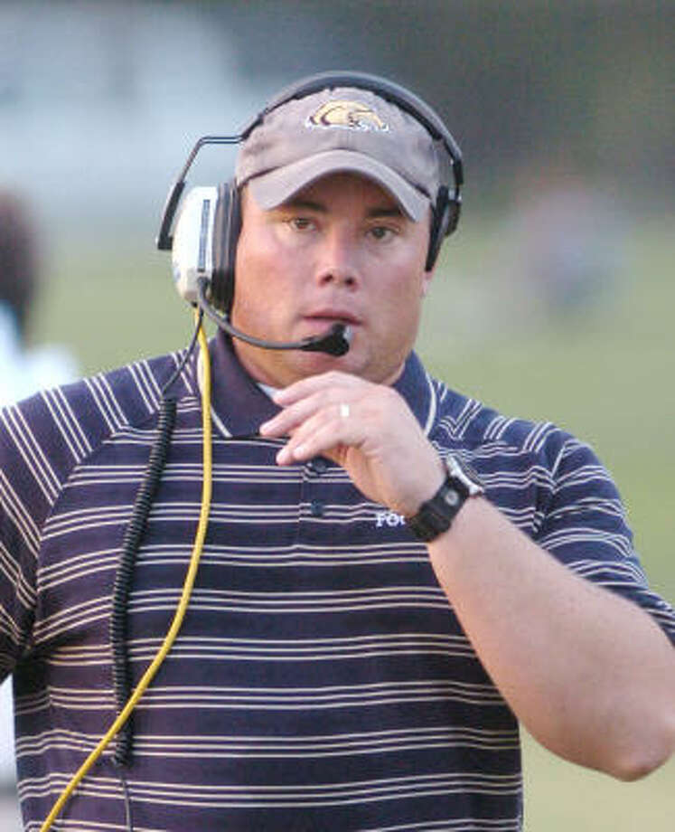 Second Baptist High School football coach, Jon Guthrie, on the sidlines duringn their game against St. John's High School , Friday, August 26, 2005     THIS WEEK/ Tim Johnson Photo: TIM JOHNSON, THIS WEEK-TIM JOHNSON